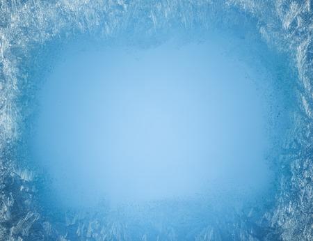 Foto de Frosty patterns on the edge of a frozen window. - Imagen libre de derechos