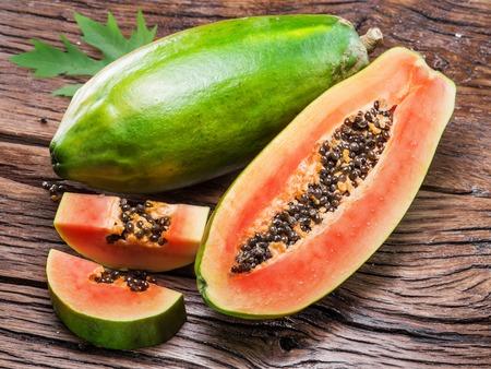 Photo for Papaya fruit on wooden background. - Royalty Free Image