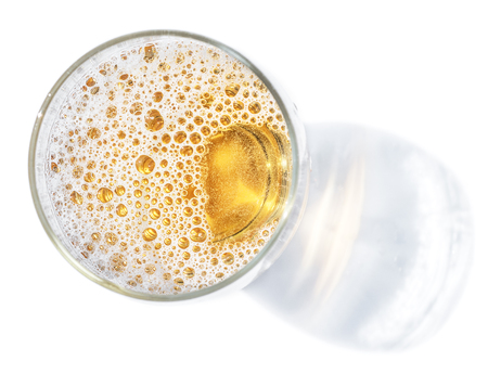 Foto de Glass of beer. Top view of lager beer or light beer on the white background. - Imagen libre de derechos