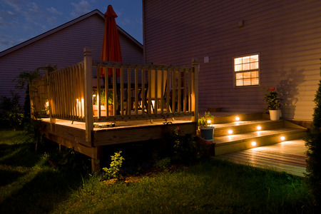 Photo for Wooden deck and patio of family home at night. - Royalty Free Image