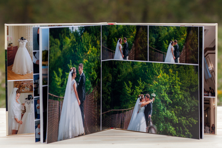 Photo for Open pages of brown luxury leather wedding book or album. - Royalty Free Image