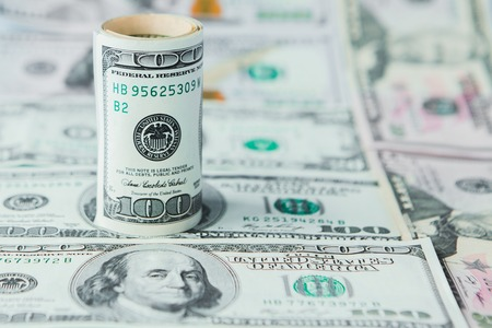 Photo for Close-up of stack of dollars against the backdrop of money. - Royalty Free Image