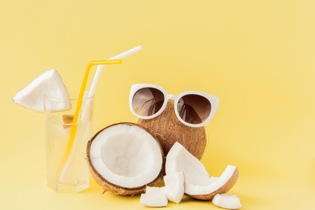 Photo for Fresh Coconut cocktail with a straws on yellow background, copy space. - Royalty Free Image