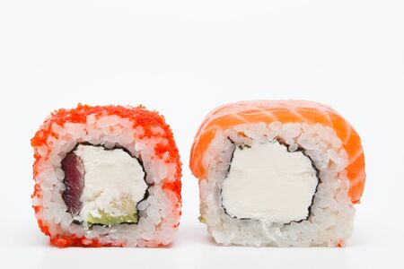 Foto de Philadelphia roll, Sushi rolls isolated on white background. Collection. Closeup of delicious japanese food with sushi roll.. - Imagen libre de derechos