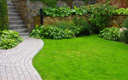Photo for Garden stone path with grass growing up between the stones - Royalty Free Image