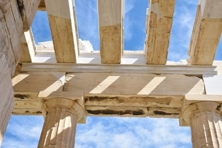 Photo for Roof structure and ceiling of Propylaea, monumental gateway Acropolis shown doric columns and architrave built with marble and limestone on blue sky background, Athens, Greece - Royalty Free Image