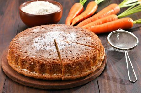 Photo pour Carrot cake, flour and fresh carrot on wooden table - image libre de droit
