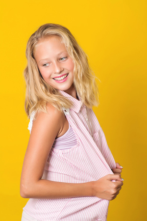 Photo for Handsome young girl posing on the yellow background. - Royalty Free Image