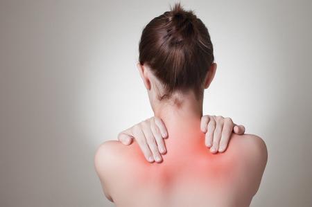 Photo pour Rear view of a young woman touching her back - image libre de droit