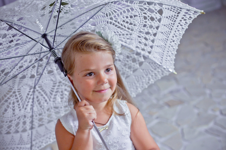 Photo for Sad girl with lace umbrella. child thought. Lovely girl in white dress. - Royalty Free Image