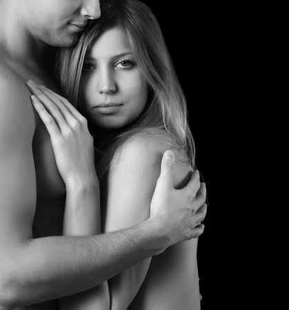 Foto de Beautiful young pair on a black  background - Imagen libre de derechos