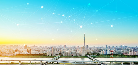 Photo pour Business concept for information, communication , connection technology - panoramic modern city skyline bird eye aerial view under dramatic glow and beautiful dark blue sky - image libre de droit