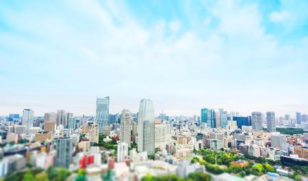 Foto de Business and culture concept - panoramic modern city skyline bird eye aerial view from tokyo tower under dramatic grey cloudy sky in Tokyo, Japan. Miniature Tilt-shift effect - Imagen libre de derechos