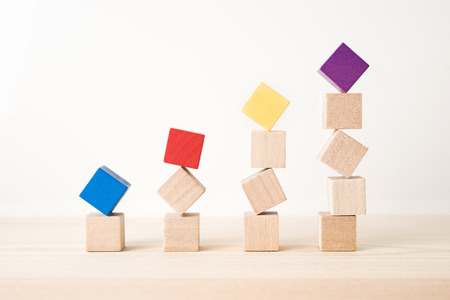 Photo pour Business and design concept - abstract geometric real wooden colored cube on wooden floor background and it's not 3D render. It's the symbol of economy  growth - image libre de droit
