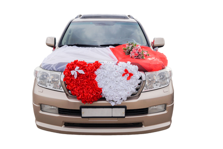 Photo for The wedding car decorated with flowers on a white background. - Royalty Free Image