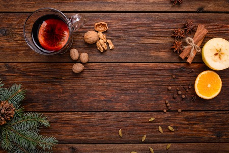 Photo for Mulled wine punch and spices for glintwine on vintage wooden table background top view - Royalty Free Image