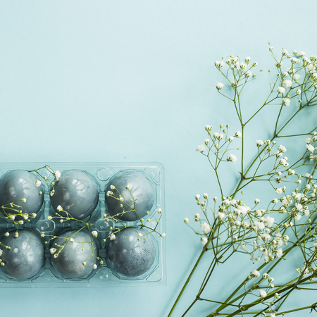 Foto für Delicate blue Easter eggs among the flowers of gypsophila on a blue background - Lizenzfreies Bild
