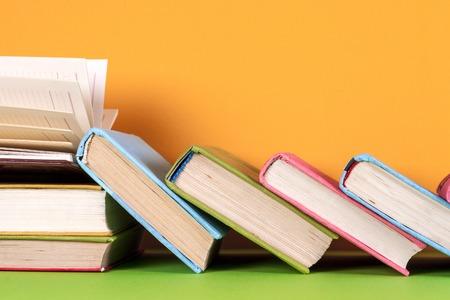 Photo pour Open book, hardback books on bright colorful background. - image libre de droit