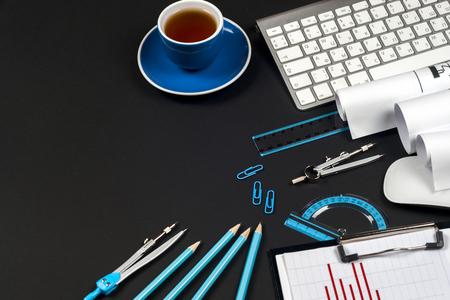 Photo pour Workplace of architect - rolls and plans. - image libre de droit