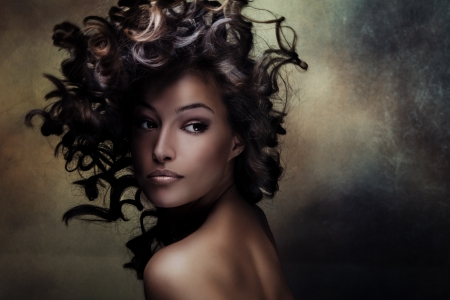 beautiful black young woman beauty shot with hair in motion