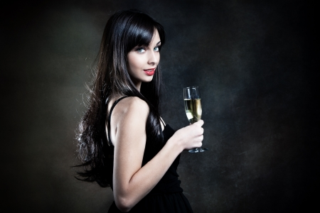 Photo pour smiling beautiful elegant young woman with glass of champagne studio shot - image libre de droit
