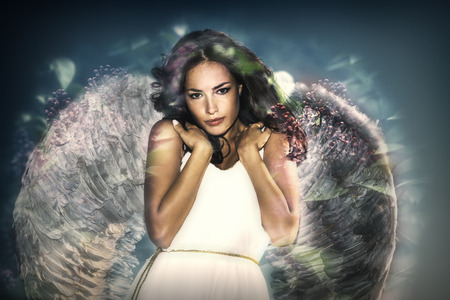 Photo for beautiful like angel young  woman with wings double exposure - Royalty Free Image