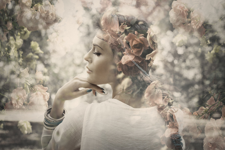 Photo for fantasy beautiful young woman like fairy, double exposure with roses, small amount of grain added - Royalty Free Image