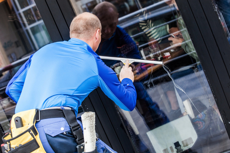 Photo for window washer working  wash glass on building - Royalty Free Image