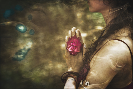 Photo for close up of yoga woman hands in namaste gesture with rose flower, vintage look - Royalty Free Image