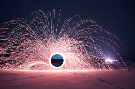 Photo pour steel wool photo, a Mysterious portal of sparks in the winter night, a black hole, strange things happen this night - image libre de droit