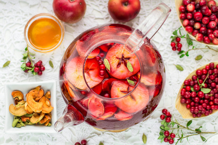 Photo for Fruit tea from apples, cranberries, cowberry  and cardamom. Hot Christmas drink - Royalty Free Image