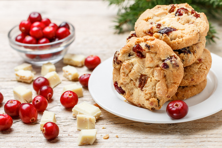 Photo for Homemade Christmas cranberry cookies with white chocolate in a bowl on the table. Rustic style. Selective focus - Royalty Free Image
