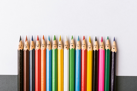 Photo for Color pencils with faces painted on them. the concept of a multinational family and equality in the world. - Royalty Free Image