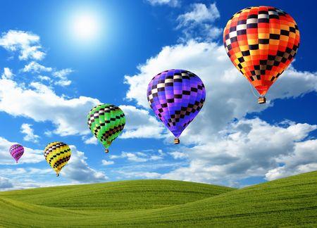 Foto de Hot air balloons floating in the sky over land - Imagen libre de derechos
