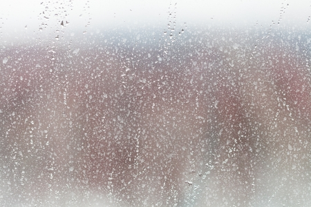 abstract background with rain drops on home glass window