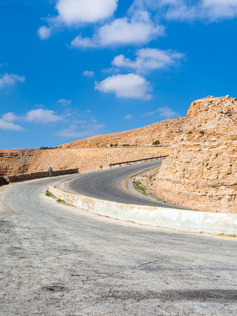 Travel to Middle East country Kingdom of Jordan - turn on King's highway in mountain near Al Mujib dam in winter