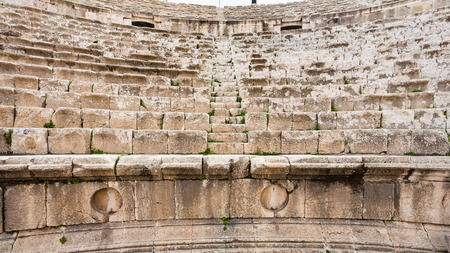Travel to Middle East country Kingdom of Jordan - stone seats of roman Large South Theatre in Jerash (ancient Gerasa) town in winter