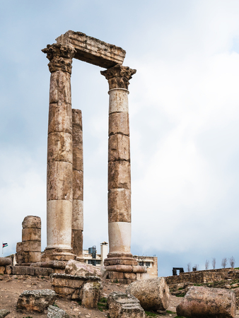 Travel to Middle East country Kingdom of Jordan - columns of Temple of Hercules at Amman Citadel in rainy day in winter