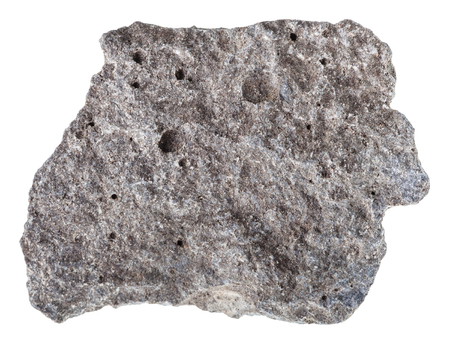 Photo pour macro shooting of specimen of natural igneous rock - piece of porous basalt stone isolated on white background from Russia - image libre de droit