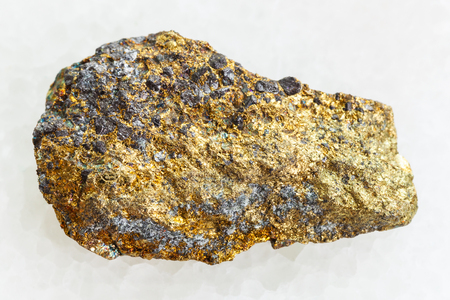 Photo for macro shooting of natural mineral rock specimen - rough pyrite ore on white marble background - Royalty Free Image