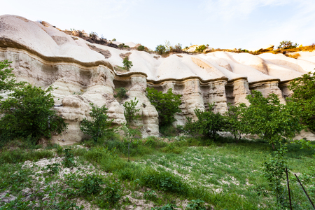 Foto de Travel to Turkey - rocks in ravine near Goreme town in Cappadocia in spring - Imagen libre de derechos