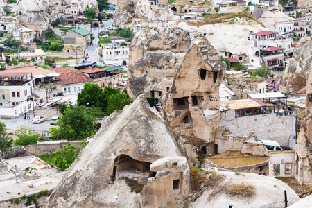 Foto de Travel to Turkey - ancient cave houses in Goreme town in Cappadocia in spring - Imagen libre de derechos