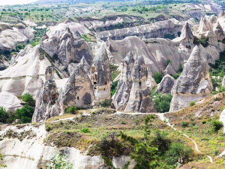 Foto de Travel to Turkey - old rock-cut houses in Goreme National Park in Cappadocia in spring - Imagen libre de derechos
