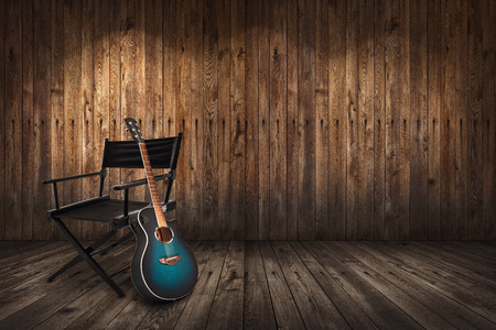 Photo pour Guitar and chair on the floor and background of wooden planks - image libre de droit