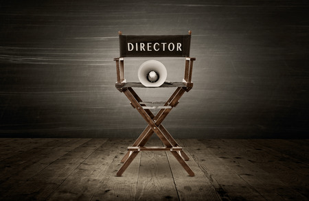 Photo pour Director chair and megaphone, scene in dark room - image libre de droit