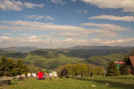 Foto de People chilling out on the sunbeds on the top of the mountain, Czantoria, Poland - Imagen libre de derechos