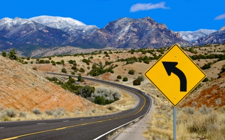 Photo pour Curve Warning Sign:  A road sign alerts motorists to a curving mountain road in northern New Mexico. - image libre de droit