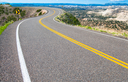 Photo for Scenic Road   A two lane road curves along a canyon rim in southern Utah  - Royalty Free Image