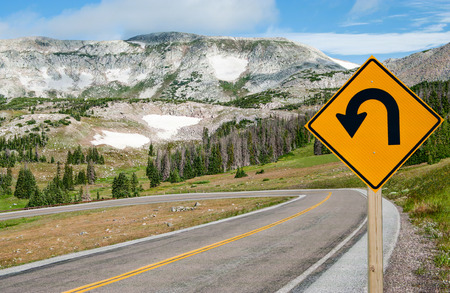 Photo pour U-Turn Sign:  A sign warns motorists of a sharp bend ahead on a mountain road in southern Wyoming. - image libre de droit