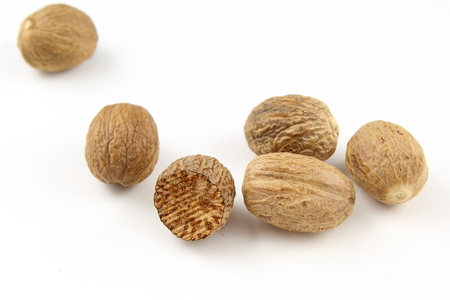 Photo pour composition of nutmeg seeds isolated on a white background - image libre de droit